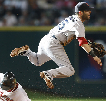 HOUSTON - JULY 02:  Second baseman Dustin Pedroia #15 of the Boston Red Sox leaps over Hunter Pence #9 of the Houston Astros to complete a double play in the first inning at Minute Maid Park on July 2, 2011 in Houston, Texas.  (Photo by Bob Levey/Getty Im