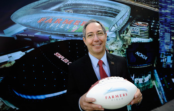 LOS ANGELES, CA - FEBRUARY 01: Farmers Insurance Exchange executives Paul Patsis holds a football after an event announcing naming rights for the new football stadium Farmers Field at Los Angeles Convention Center on February 1, 2011 in Los Angeles, Calif
