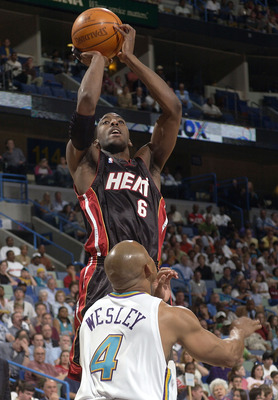 NEW ORLEANS - MAY 2:  Eddie Jones #6 of the Miami Heat shoots over David Wesley #4 of the New Orleans Hornets in Game Six of the Eastern Conference Quarterfinals during NBA Playoffs May 2, 2004 at the New Orleans Arena in New Orleans, Louisiana. NOTE TO U