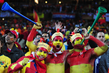 JOHANNESBURG, SOUTH AFRICA - JULY 11:  Spain fans enjoy the atmosphere during the 2010 FIFA World Cup South Africa Final match between Netherlands and Spain at Soccer City Stadium on July 11, 2010 in Johannesburg, South Africa.  (Photo by Clive Mason/Gett