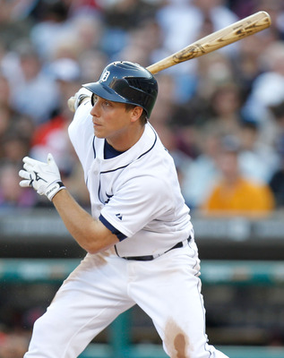 DETROIT, MI - JUNE 14: Andy Dirks #12 of the Detroit Tigers hits a third inning single that drives in a run while playing the Cleveland Indians at Comerica Park on June 14, 2011 in Detroit, Michigan. (Photo by Gregory Shamus/Getty Images)