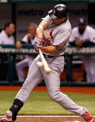 ST PETERSBURG, FL - JULY 01:  Outfielder Lance Berkman #12 of the St. Louis Cardinals doubles in the second inning against the Tampa Bay Rays during the game at Tropicana Field on July 1, 2011 in St. Petersburg, Florida.  (Photo by J. Meric/Getty Images)