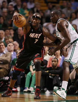 BOSTON - APRIL 27:  Jermaine O'Neal #7 of the Miami Heat tries to hang on to the ball as Kendrick Perkins #43 of the Boston Celtics defends during Game Five of the Eastern Conference Quarterfinals of the 2010 NBA playoffs at the TD Garden on April 27, 201