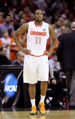 CLEVELAND, OH - MARCH 20:  Scoop Jardine #11 of the Syracuse Orange looks on during the game against the Marquette Golden Eagles during the third of the 2011 NCAA men's basketball tournament at Quicken Loans Arena on March 20, 2011 in Cleveland, Ohio.  (P