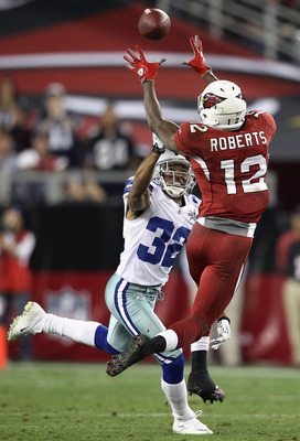 GLENDALE, AZ - DECEMBER 25:  Wide receiver Andre Roberts #12 of the Arizona Cardinals makes a leaping reception over Orlando Scandrick #32 of the Dallas Cowboys during the NFL game at the University of Phoenix Stadium on December 25, 2010 in Glendale, Ari
