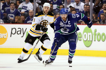 VANCOUVER, BC - JUNE 15:  Henrik Sedin #33 of the Vancouver Canucks skates against Gregory Campbell #11 of the Boston Bruins during Game Seven of the 2011 NHL Stanley Cup Final at Rogers Arena on June 15, 2011 in Vancouver, British Columbia, Canada.  (Pho