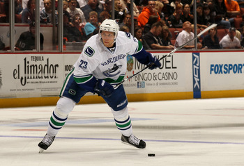 ANAHEIM, CA - OCTOBER 1:  Alex Edler #23 of the Vancouver Canucks fires a slapshot and scores their second goal against the Anaheim Ducks at Honda Center on October 1, 2010 in Anaheim, California.  Vancouver won 4-2.  (Photo by Stephen Dunn/Getty Images)