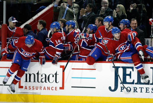 MONTREAL, QC - OCTOBER 25:  Members of the Montreal Canadiens jump the boards after defeating the Phoenix Coyotes in overtime during the NHL game at the Bell Centre on October 25, 2010 in Montreal, Quebec, Canada.  The Canadiens defeated the Coyotes 3-2 i