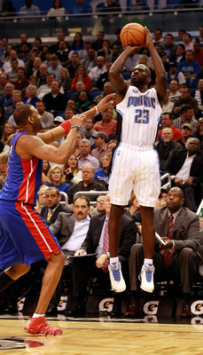 ORLANDO, FL - JANUARY 24:  Jason Richardson #23 of the Orlando Magic attempts a shot over Tracy McGrady #1 of the Detroit Pistons during the game at Amway Arena on January 24, 2011 in Orlando, Florida.  NOTE TO USER: User expressly acknowledges and agrees