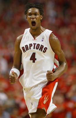 TORONTO,ON - APRIL 24:  Chris Bosh #4 of the Toronto Raptors celebrates another basket against the Orlando Magic in game 3 of the Eastern Conference quarterfinals on April 24, 2008 at the Air Canada Centre in Toronto, Ontario. (Photo by Claus Andersen/Get