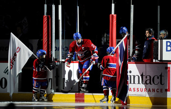 MONTREAL, CANADA - APRIL 26:  Brian Gionta #21 of the Montreal Canadiens jumps out onto the ice during pre-game introductions before Game Six of the Eastern Conference Quarterfinals against the Boston Bruins during the 2011 NHL Stanley Cup Playoffs at the