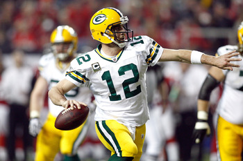 ATLANTA, GA - JANUARY 15:  Aaron Rodgers #12 of the Green Bay Packers looks to pass against the Atlanta Falcons during their 2011 NFC divisional playoff game at Georgia Dome on January 15, 2011 in Atlanta, Georgia. The Packers won 48-21. (Photo by Chris G