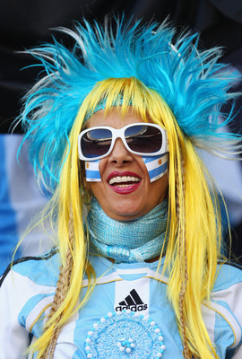 CAPE TOWN, SOUTH AFRICA - JULY 03:  An Argentina fan enjoys the atmosphere ahead of the 2010 FIFA World Cup South Africa Quarter Final match between Argentina and Germany at Green Point Stadium on July 3, 2010 in Cape Town, South Africa.  (Photo by Camero