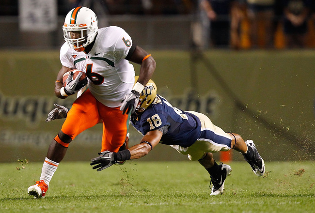 PITTSBURGH - SEPTEMBER 23:  Lamar Miller #6 of the Miami Hurricanes runs through an attempted tackle by Jarred Holley #18 of the Pittsburgh Panthers on September 23, 2010 at Heinz Field in Pittsburgh, Pennsylvania.  (Photo by Jared Wickerham/Getty Images)
