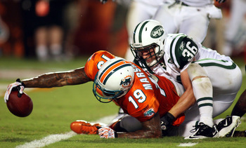 MIAMI - SEPTEMBER 26:  Receiver Brandon Marshall #19 of the Miami Dolphins scores a touchdown against the New York Jets at Sun Life Stadium on September 26, 2010 in Miami, Florida.  (Photo by Marc Serota/Getty Images)