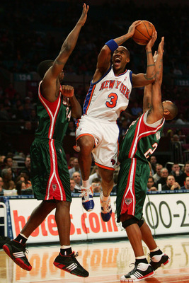 NEW YORK - NOVEMBER 30:  Stephon Marbury #3 of the New York Knicks drives through Desmond Mason #24 (L) and Mo Williams #25 of the Milwaukee Bucks on November 30, 2007 at Madison Square Garden in New York City. NOTE TO USER: User expressly acknowledges an