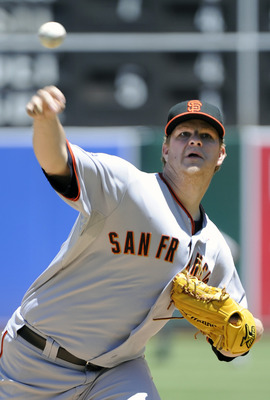 OAKLAND, CA -  JUNE 19: Matt Cain #18 of the San Francisco Giants pitches against the Oakland Athletics in the bottom of the second inning during a MLB baseball game June 19, 2011 at the Oakland-Alameda County Coliseum in Oakland, California. (Photo by Th