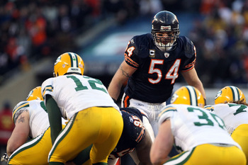 CHICAGO, IL - JANUARY 23:  Brian Urlacher #54 of the Chicago Bears looks over at Aaron Rodgers #12 of the Green Bay Packers before the snap in the NFC Championship Game at Soldier Field on January 23, 2011 in Chicago, Illinois.  (Photo by Doug Pensinger/G