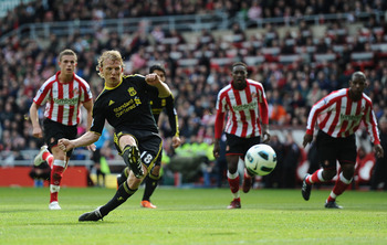 SUNDERLAND, ENGLAND - MARCH 20:  Dirk Kuyt of Liverpool fires home the first goal from the penalty spot during the Barclays Premier League match between Sunderland and Liverpool at the Stadium of Light on March 20, 2011 in Sunderland, England.  (Photo by