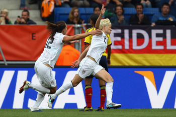 SINSHEIM, GERMANY - JULY 02: Megan Rapinoe (R) of USA celebrates her team's second goal with team mate Lauren Cheney during the FIFA Women's World Cup 2011 Group C match between USA and Colombia at the Fifa Womens World Cup Stadium on July 2, 2011 in Sins