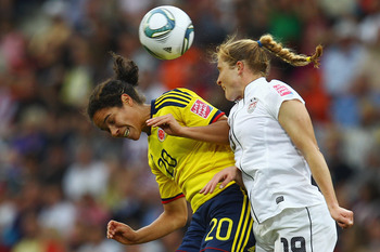 SINSHEIM, GERMANY - JULY 02: Orianica Velasquez (L) of Colombia jumps for a header with Rachel Buehler of USA during the FIFA Women's World Cup 2011 Group C match between USA and Colombia at the Fifa Womens World Cup Stadium on July 2, 2011 in Sinsheim, G