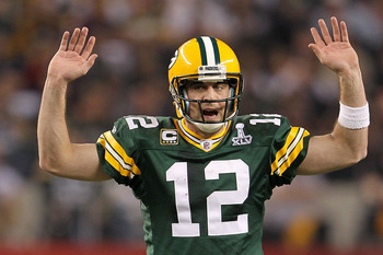 ARLINGTON, TX - FEBRUARY 06:  Quarterback Aaron Rodgers #12 of the Green Bay Packers calls out from under center against the Pittsburgh Steelers during Super Bowl XLV at Cowboys Stadium on February 6, 2011 in Arlington, Texas.  (Photo by Jamie Squire/Gett