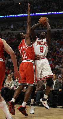 CHICAGO, IL - DECEMBER 28: Loul Deng #9 of the Chicago Bulls puts up a shot over Luc Mbah a Moute #12 of the Milwaukee Bucks on his way to 24 points at the United Center on December 28, 2010 in Chicago, Illinois. The Bulls defeated the Bucks 90-77. NOTE T
