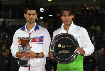 ROME, ITALY - MAY 15:  Novak Djokovic of Serbia holds the trophy after his victory in the final against Rafael Nadal of Spain during day eight of the Internazoinali BNL D'Italia at the Foro Italico Tennis Centre on May 15, 2011 in Rome, Italy.  (Photo by
