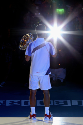 MELBOURNE, AUSTRALIA - JANUARY 30:  Novak Djokovic of Serbia poses with the Norman Brookes Challenge Cup after winning his men's final match against Andy Murray of Great Britain during day fourteen of the 2011 Australian Open at Melbourne Park on January
