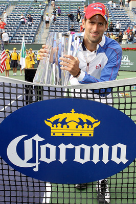 INDIAN WELLS, CA - MARCH 20:  Novak Djokovic of Serbia poses for photographers with the winner's trophy after defeating Rafael Nadal of Spain during the final of the BNP Paribas Open at the Indian Wells Tennis Garden on March 20, 2011 in Indian Wells, Cal