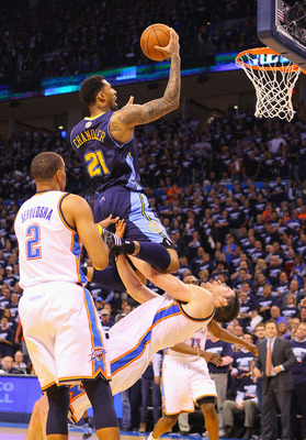 OKLAHOMA CITY, OK - APRIL 27: Wilson Chandler #21 of the Denver Nuggets drives to the basket against Nick Collison #4 of the Oklahoma City Thunder in Game Five of the Western Conference Quarterfinals in the 2011 NBA Playoffs on April 27, 2011 at the Ford