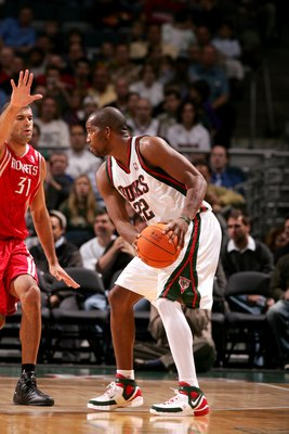 MILWAUKEE - NOVEMBER 8:  Michael Redd #22 of the Milwaukee Bucks is defended by Shane Battier #31 of the Houston Rockets during the game on November 8, 2006 at the Bradley Center in Milwaukee, Wisconsin. The Rockets won 97-93. NOTE TO USER: User expressly