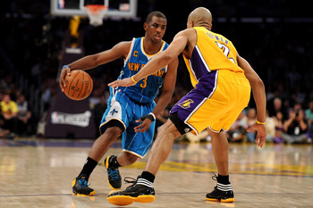 LOS ANGELES, CA - APRIL 26:  Chris Paul #3 of the New Orleans Hornets drives on Derek Fisher #2 of the Los Angeles Lakers in Game Five of the Western Conference Quarterfinals in the 2011 NBA Playoffs on April 26, 2011 at Staples Center in Los Angeles, Cal