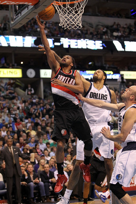 DALLAS, TX - JANUARY 04:  Guard Patrick Mills #8 of the Portland Trail Blazers takes a shot against Tyson Chandler #6 of the Dallas Mavericks at American Airlines Center on January 4, 2011 in Dallas, Texas.  NOTE TO USER: User expressly acknowledges and a