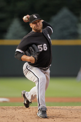DENVER, CO - JUNE 29:  Starting pitcher Mark Buehrle #56 of the Chicago White Sox delviers against the Colorado Rockies during Interleague play at Coors Field on June 29, 2011 in Denver, Colorado. The White Sox defeated the Rockies 3-2.  (Photo by Doug Pe