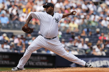NEW YORK, NY - JUNE 30:  CC Sabathia #52 of the New York Yankees pitches against the Milwaukee Brewers during their game on June 30, 2011 at Yankee Stadium in the Bronx borough of New York City.  (Photo by Al Bello/Getty Images)