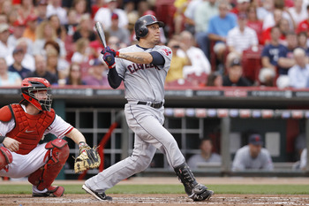 CINCINNATI, OH - JULY 1: Asdrubal Cabrera #13 of the Cleveland Indians hits a two-run home run in the third inning against the Cincinnati Reds at Great American Ball Park on July 1, 2011 in Cincinnati, Ohio. (Photo by Joe Robbins/Getty Images)