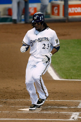 MILWAUKEE, WI - JUNE 22: Rickie Weeks #23 of the Milwaukee Brewers steps on home plate to score a run against the Tampa Bay Rays at Miller Park on June 22, 2011 in Milwaukee, Wisconsin. The Rays defeated the Brewers 6-3. (Photo by Scott Boehm/Getty Images