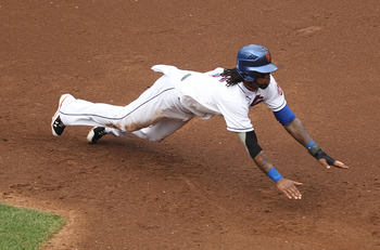 NEW YORK, NY - JULY 02:  Jose Reyes #7 of the New York Mets dives safely back to first base after getting caught in a rundown against the New York Yankees during their game on July 2, 2011 at Citi Field in the Flushing neighborhood of the Queens borough o