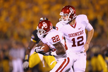COLUMBIA, MO - OCTOBER 23: Landry Jones #12 of the Oklahoma Sooners hands the ball off to Roy Finch #22 also of the Oklahoma Sooners at Faurot Field/Memorial Stadium on October 23, 2010 in Columbia, Missouri.  The Tigers beat the Sooners 36-27.  (Photo by