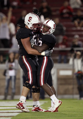 PALO ALTO, CA - SEPTEMBER 18:  Stepfan Taylor #33 of the Stanford Cardinal is congratulated by David DeCastro #52 after he scored a touchdown during their game against the Wake Forest Demon Deacons at Stanford Stadium on September 18, 2010 in Palo Alto, C