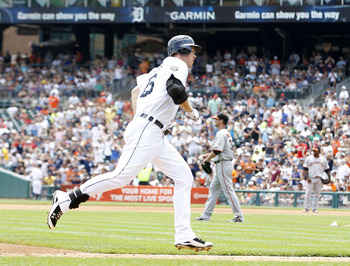 DETROIT - JULY 03: Brennan Boesch #26 of the Detroit Tigers pitches rounds third base after hitting a solo home run in the fourth inning during the game against the San Francisco Giants at Comerica Park on July 3, 2011 in Detroit, Michigan.  (Photo by Leo