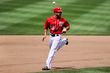WASHINGTON, DC - JUNE 18: Danny Espinosa #18 of the Washington Nationals is trapped in a rundown during the fourth inning against the Baltimore Orioles at Nationals Park on June 18, 2011 in Washington, DC. The Washington Nationals won, 4-2. (Photo by Patr