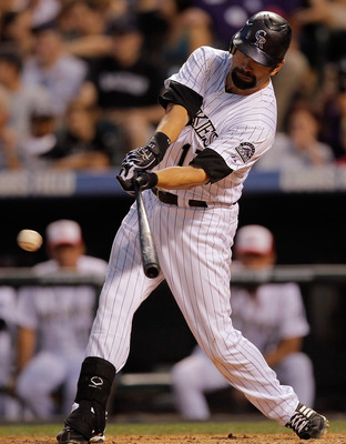 DENVER, CO - JULY 1:  Todd Helton #17 of the Colorado Rockies singles in the eighth inning against relief pitcher Joakim Soria #48 of the Kansas City Royals at Coors Field on July 1, 2011 in Denver, Colorado. The Rockies defeated the Royals 9-0. (Photo by