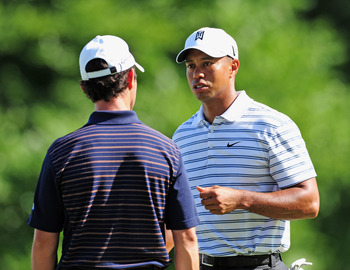AKRON, OH - AUGUST 05:  Mike Weir of Canada talks with Tiger Woods of USA during a practice round of the World Golf Championship Bridgestone Invitational on August 5, 2009 at Firestone Country Club in Akron, Ohio.  (Photo by Stuart Franklin/Getty Images)