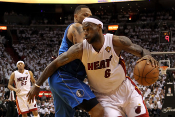 MIAMI, FL - JUNE 12:  LeBron James #6 of the Miami Heat drives against Shawn Marion #0 of the Dallas Mavericks in the second half of Game Six of the 2011 NBA Finals at American Airlines Arena on June 12, 2011 in Miami, Florida. NOTE TO USER: User expressl