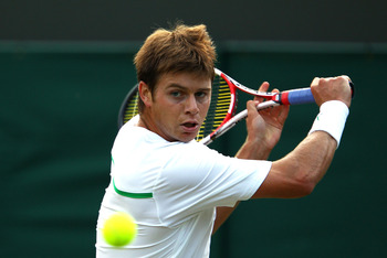 LONDON, ENGLAND - JUNE 23:  Ryan Harrison of the United States lines up a shot during his second round match against David Ferrer of Spain on Day Four of the Wimbledon Lawn Tennis Championships at the All England Lawn Tennis and Croquet Club on June 23, 2