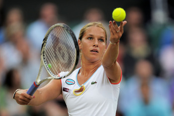LONDON, ENGLAND - JUNE 28:  Dominika Cibulkova of Slovakia serves during her quarterfinal round match against Maria Sharapova of Russia on Day Eight of the Wimbledon Lawn Tennis Championships at the All England Lawn Tennis and Croquet Club on June 28, 201
