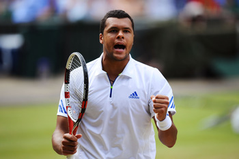 LONDON, ENGLAND - JULY 01:  Jo-Wilfried Tsonga of France reacts to a play during his semifinal round match against Novak Djokovic of Serbia on Day Eleven of the Wimbledon Lawn Tennis Championships at the All England Lawn Tennis and Croquet Club on July 1,