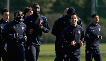 ST ALBANS, ENGLAND - MARCH 07:  Cesc Fabregas of Arsenal (R) talks to teammates during a training session ahead of the UEFA Champions League Round of 16 second leg match against Barcelona at London Colney on March 7, 2011 in St Albans, England.  (Photo by